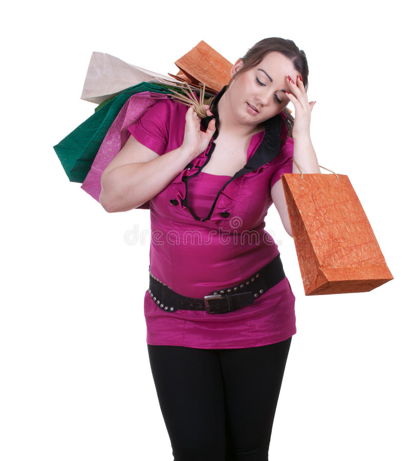 Tired fat woman with shopping bags