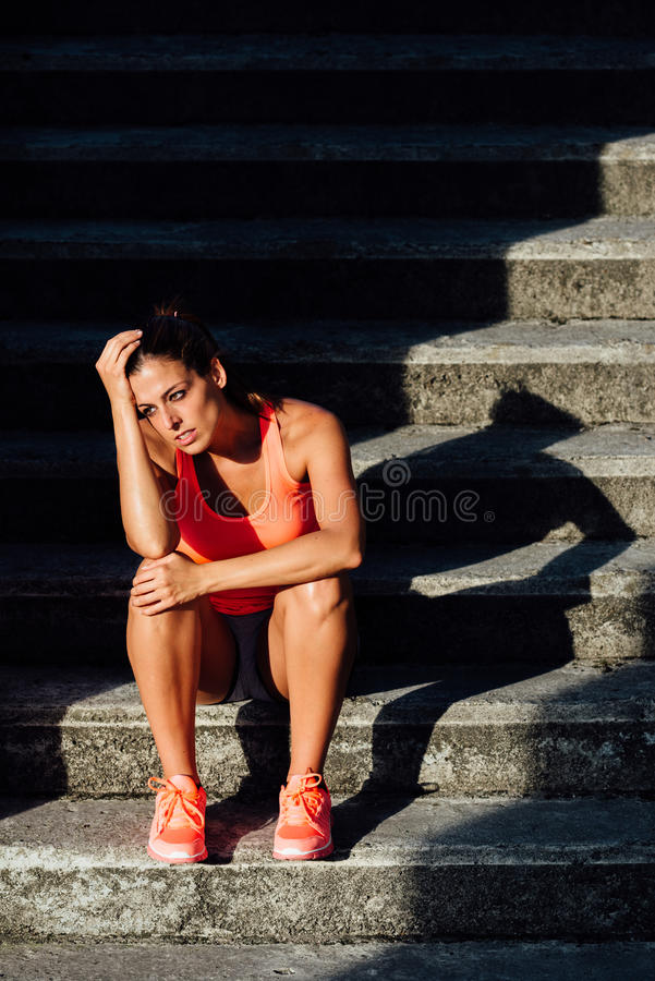 Tired Female athlete after training royalty free stock photos