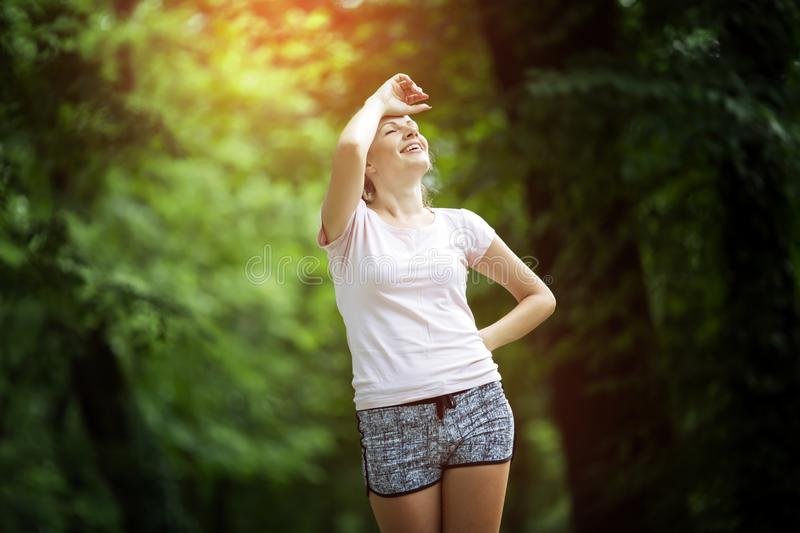 Tired female jogger. Resting after jogging stock photo