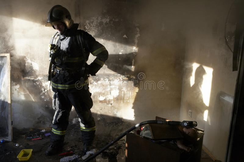 Tired firefighter royalty free stock image