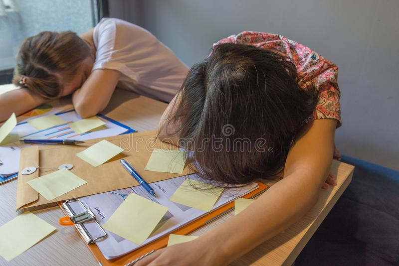 Tired and frustrated office women sleeping in office royalty free stock photos