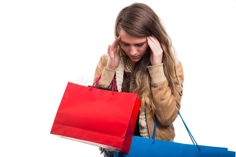 Tired girl with headache after doing shopping. All day long isolated on white royalty free stock photography