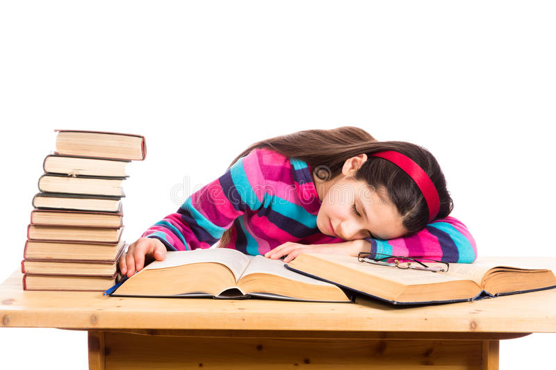 Tired girl with pile of old books royalty free stock photography