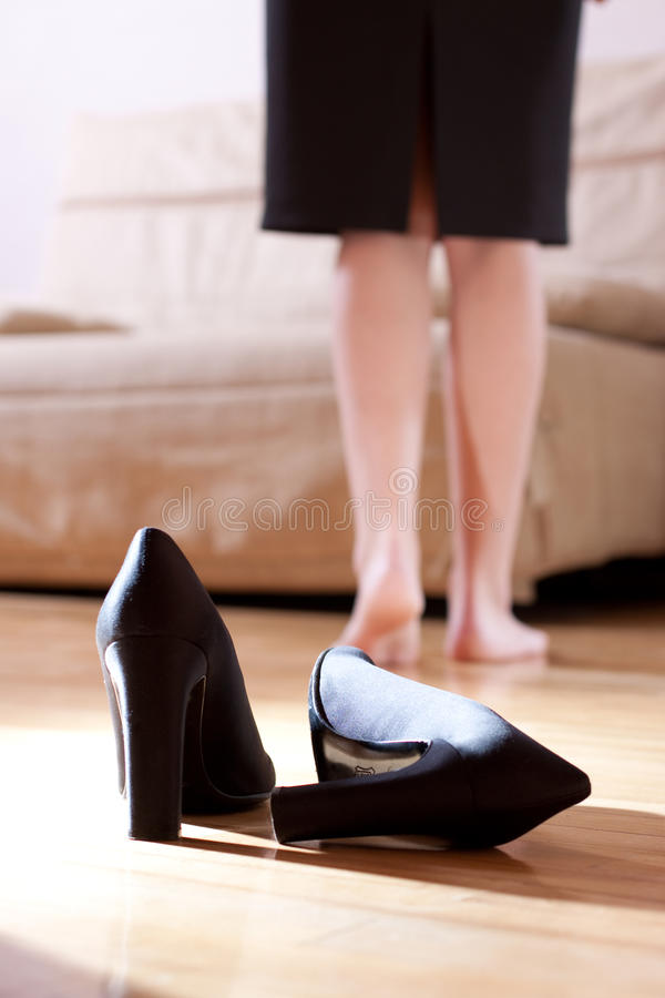 Tired girl took off her high heels stock photo