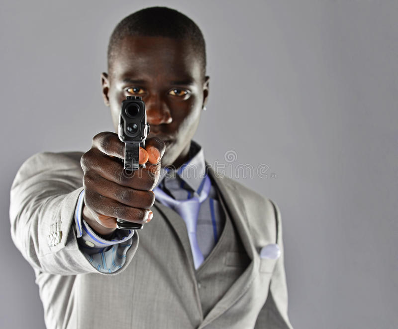 Download Man In A Suit Aims His Firearm At The Viewer Stock Photography - Image: 30285162