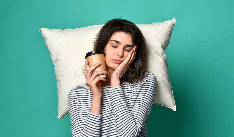 Tired happy woman drinking coffee royalty free stock image