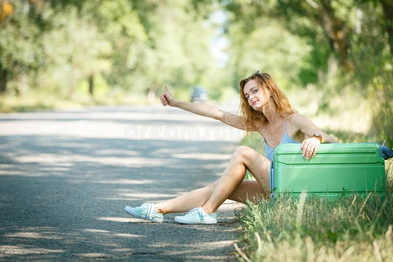 Tired Hitchhiking girl stock photography