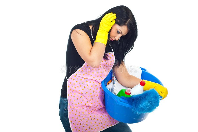 Tired housewife carrying cleaning products royalty free stock photo