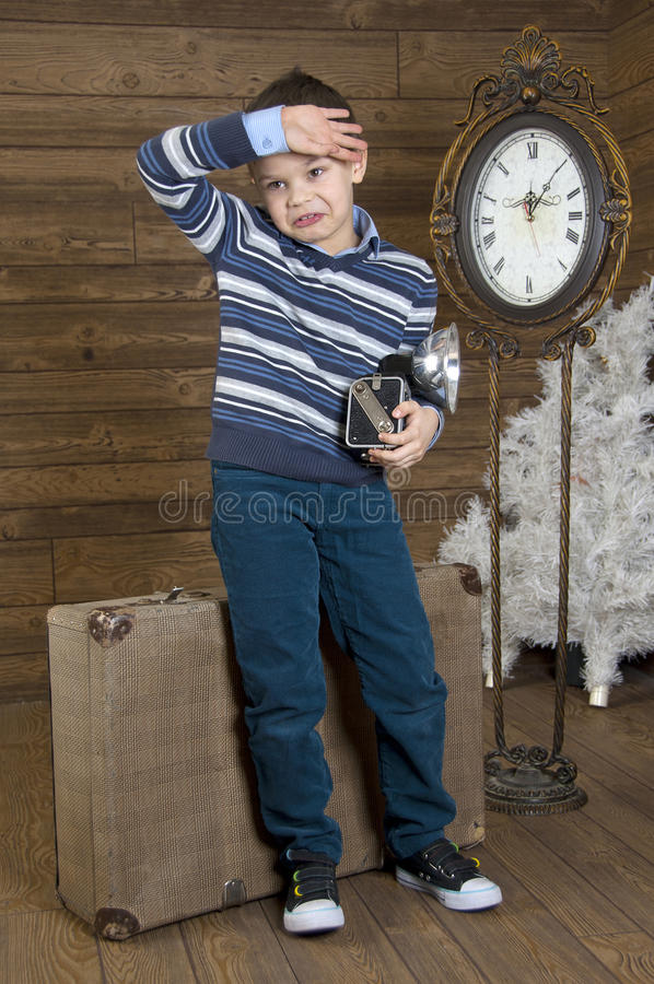 Tired little tourist with camera royalty free stock photos