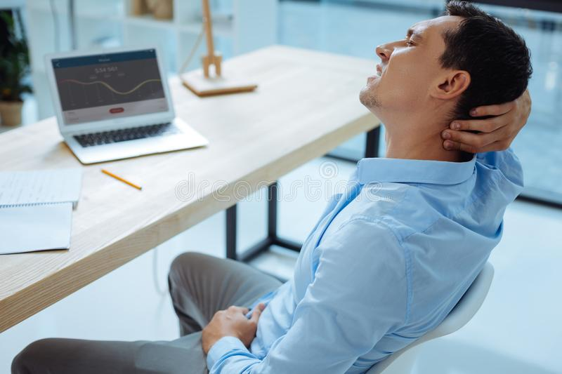 Tired male person keeping eyes closed royalty free stock images
