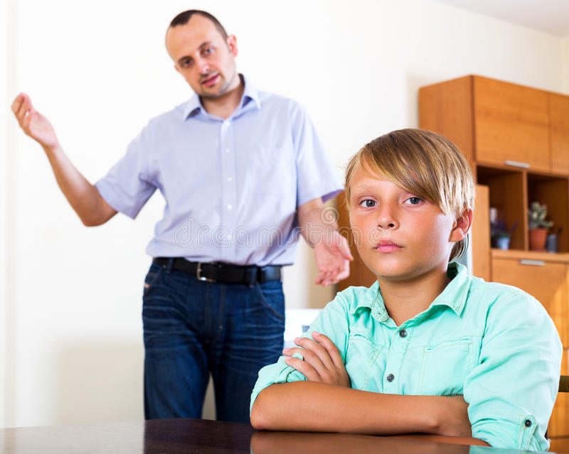 Tired man and frustrated teenager. Tired men and frustrated teenager having quarrel at home royalty free stock images
