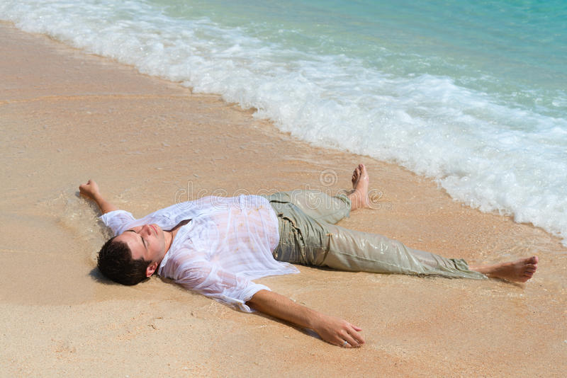 Download Tired Man Lie On Sandy Beach Stock Image - Image: 32896129