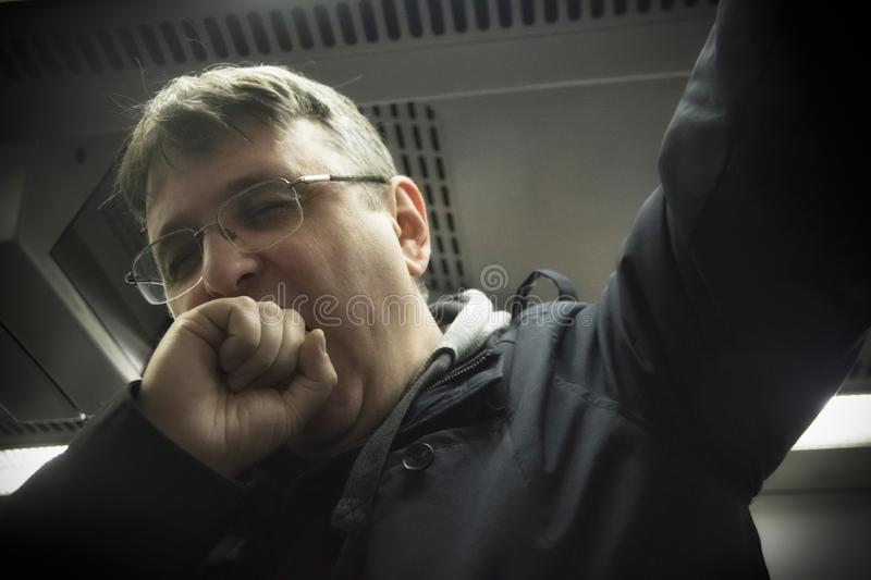 A Tired Man in a Metro stock images
