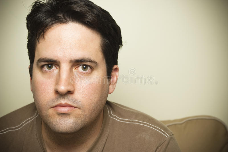 Tired man stares royalty free stock photography