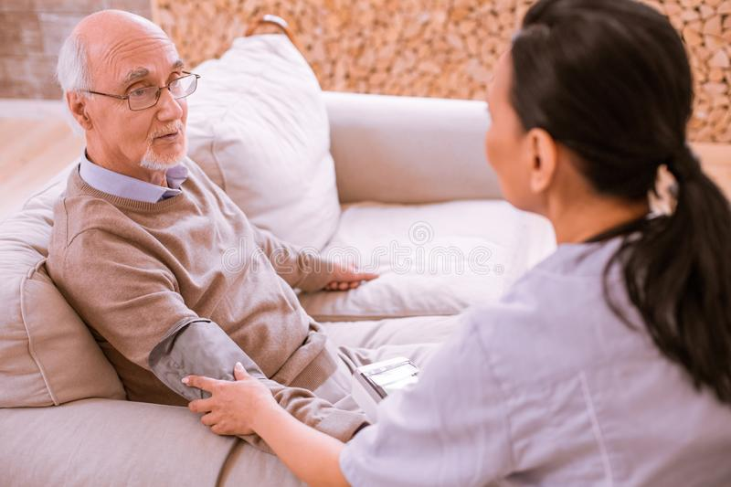Tired mature man talking to his doctor stock photo