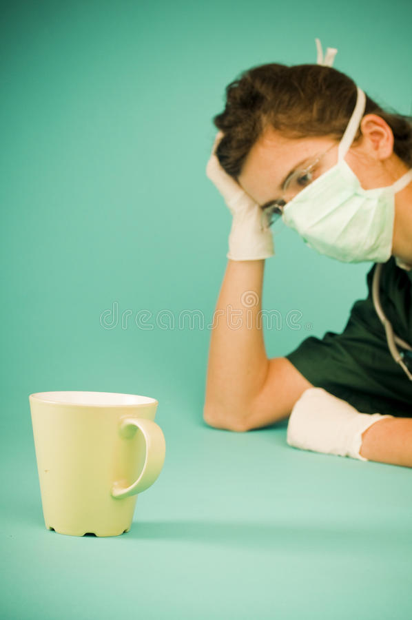 Download Tired Medic Resting After Surgery Stock Photo - Image: 19085566