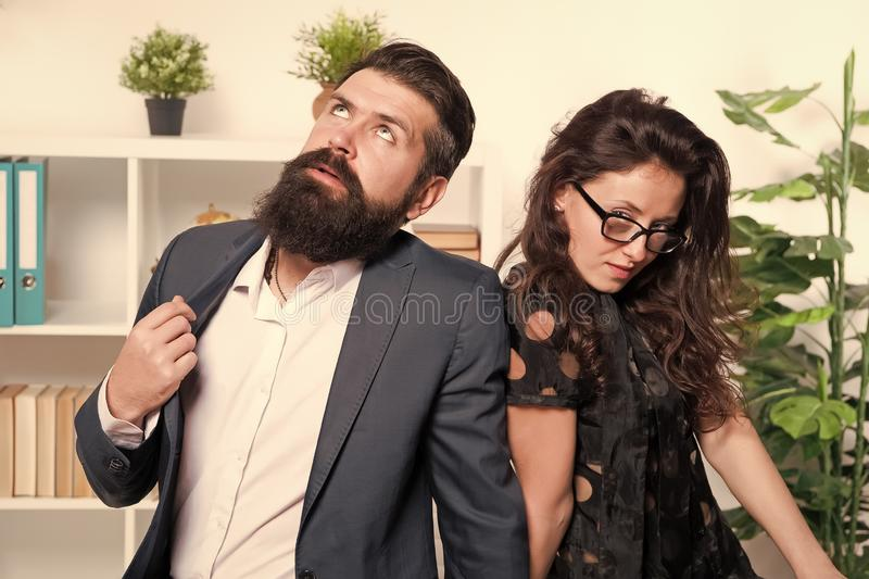 Tired man with beard and sexy woman. Young coworkers. Businesspeople. Teamwork. Business couple in office. Formal royalty free stock photography