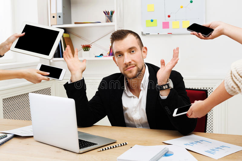 Tired from multitasking, businessman workaholic stock images