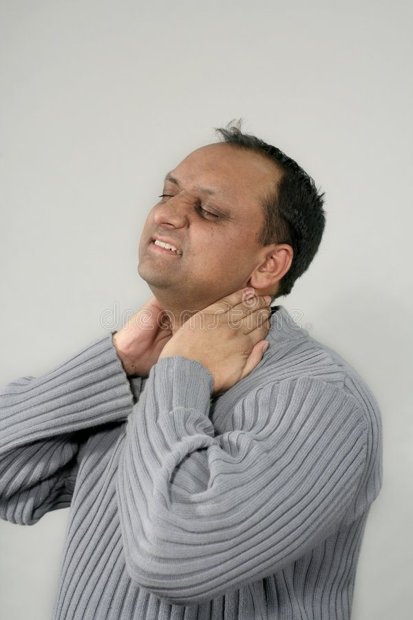 Tired and neck massage stock photography