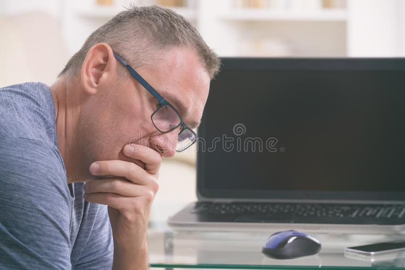 Tired and overworked freelancer at his working place royalty free stock photos