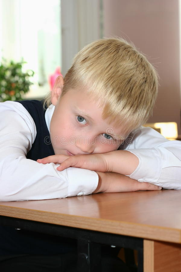 The tired pupil royalty free stock image