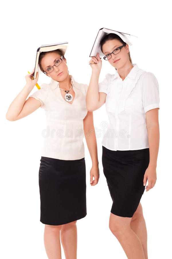Tired of reading. Two students/librarians are tired of reading on isolated white background royalty free stock photo