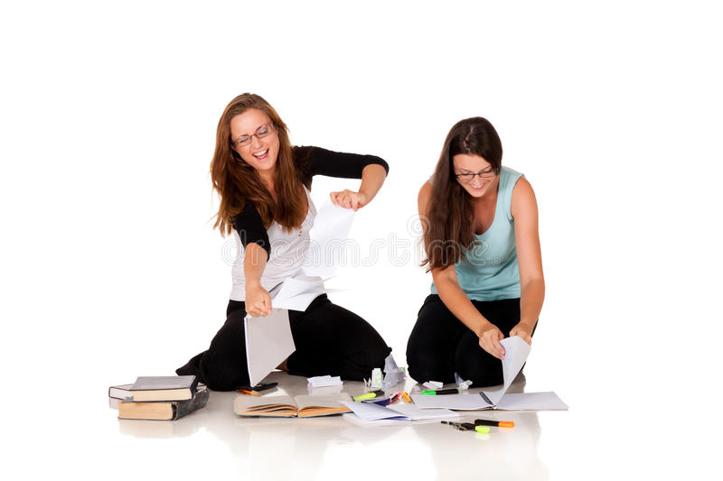 Tired of reading. Two students/librarians are tired of reading on isolated white background royalty free stock images