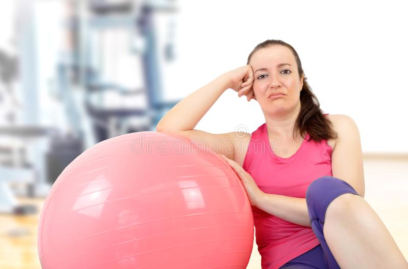 Boring woman in the fitness class stock photos