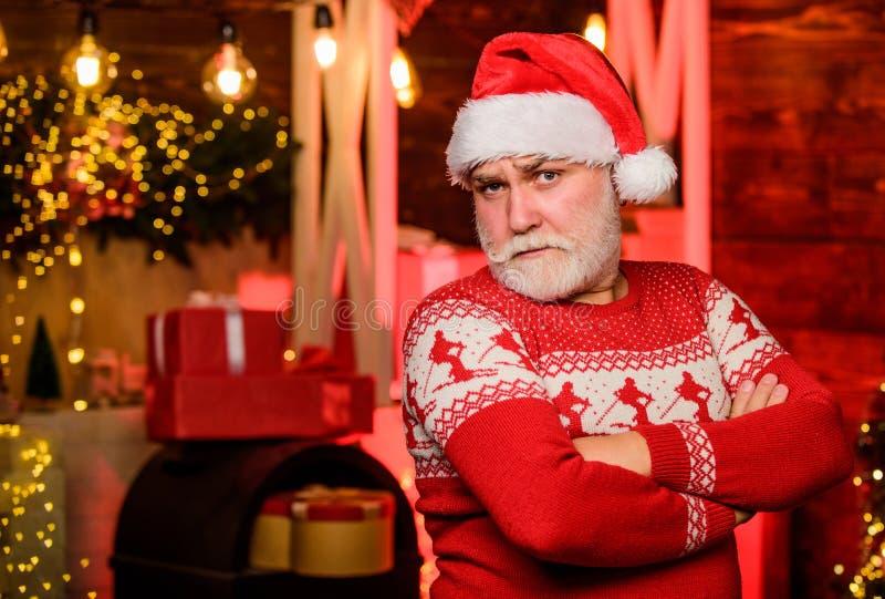 Tired santa. warm clothing in cold season. cheerful santa man red sweater. xmas gifts and presents. winter holiday royalty free stock image