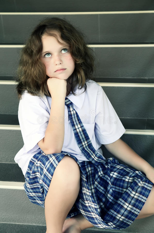 Tired schoolgirl on the stairs royalty free stock images