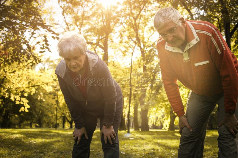 Senior couple resting after exercising. stock photos