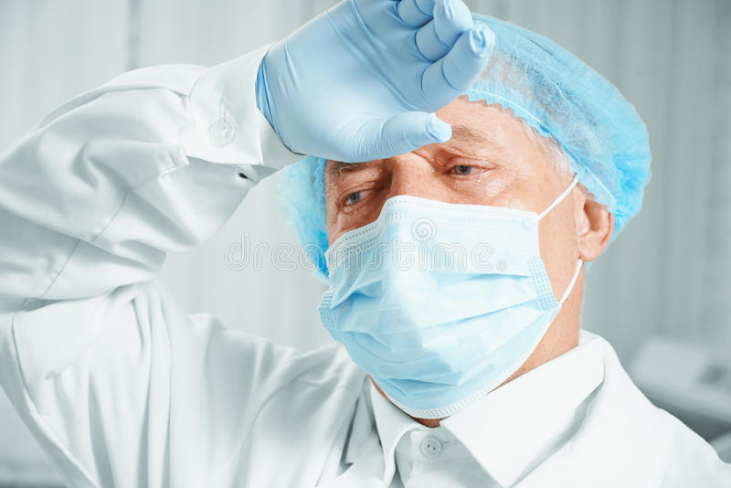 Tired senior man surgeon stock photos