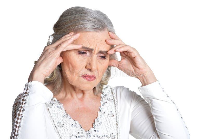 Tired senior woman. Isolate on white background royalty free stock photos