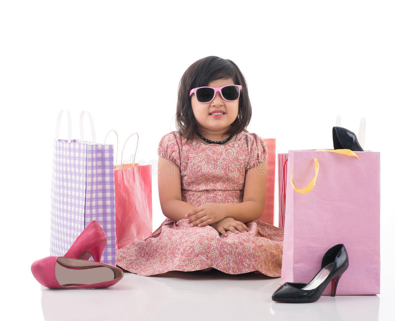 Tired of shopping. Isolated image of an upset little lady tired of shopping stock images