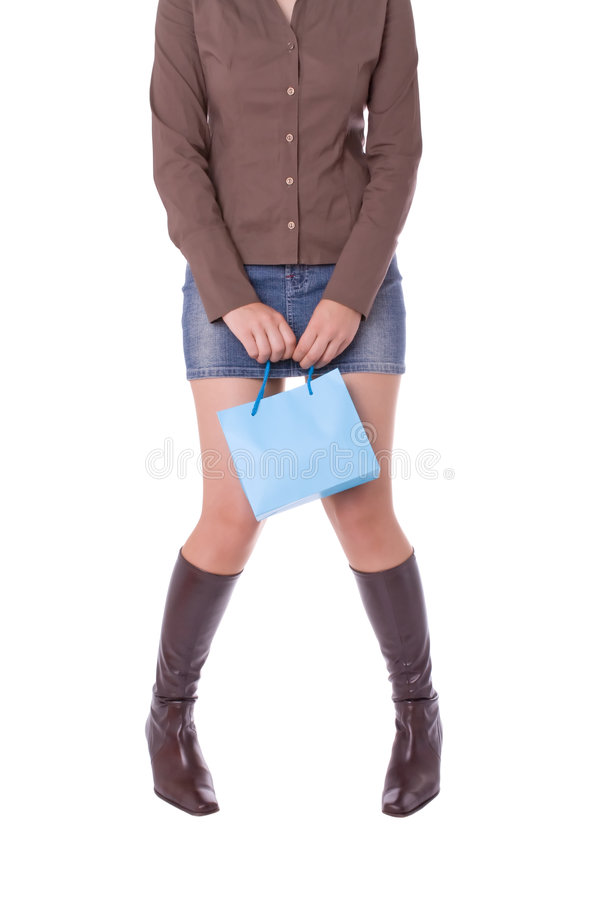Tired or shy young attractive woman. Carrying a shopping bag royalty free stock photography