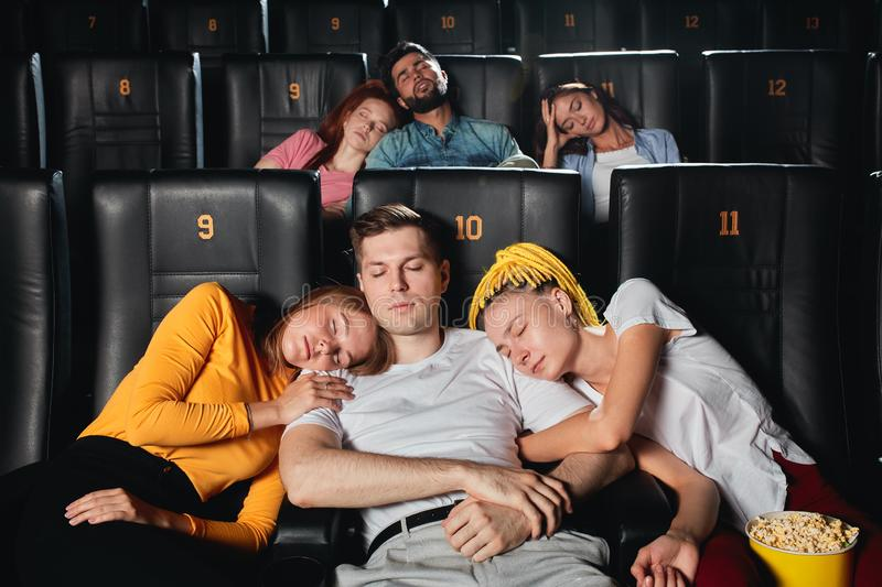 Tired sleeping audience doesn`t like the plot of film stock photos