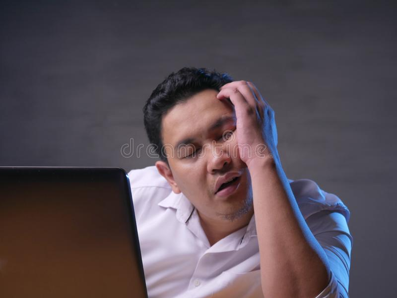 Tired Sleepy Asian Businessman Having Overworked royalty free stock photos