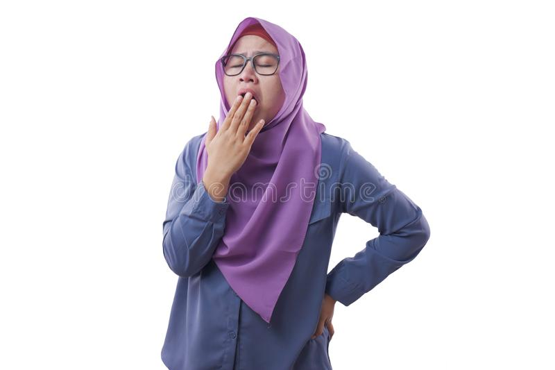 Tired Sleepy Muslim Lady Yawning, Isolated on White royalty free stock image