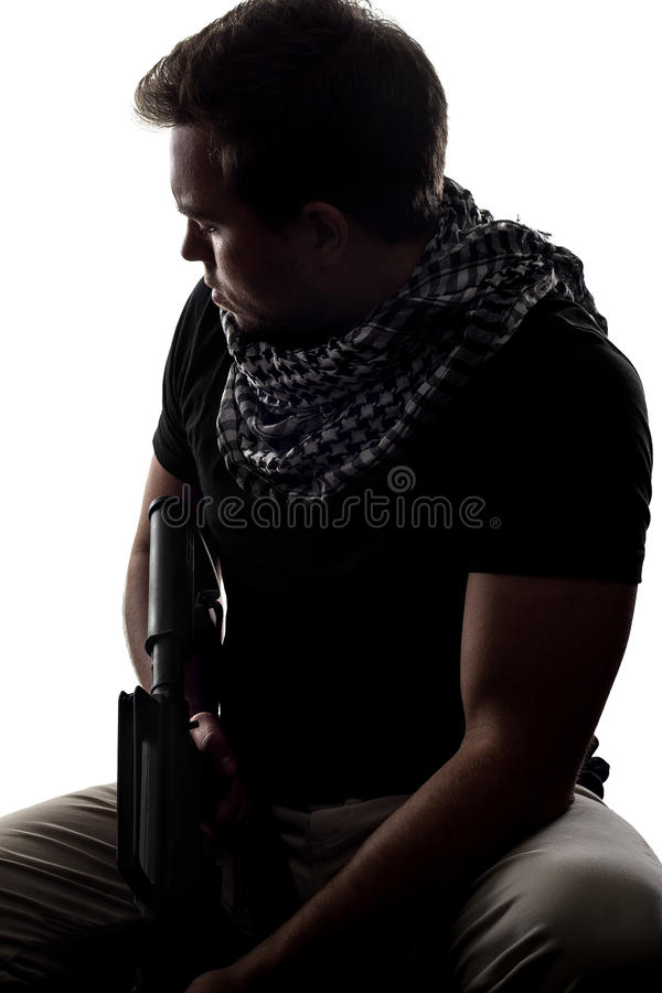 Tired Soldier. Silhouette of a model as a homesick soldier or veteran suffering from PTSD stock image