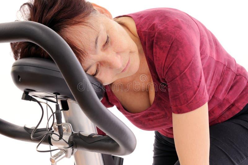 Tired spinning senior woman stock photos