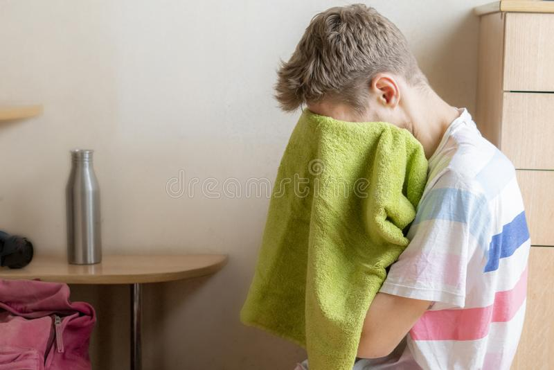 Tired sportsman athlete sitting with towel and relax f royalty free stock photo