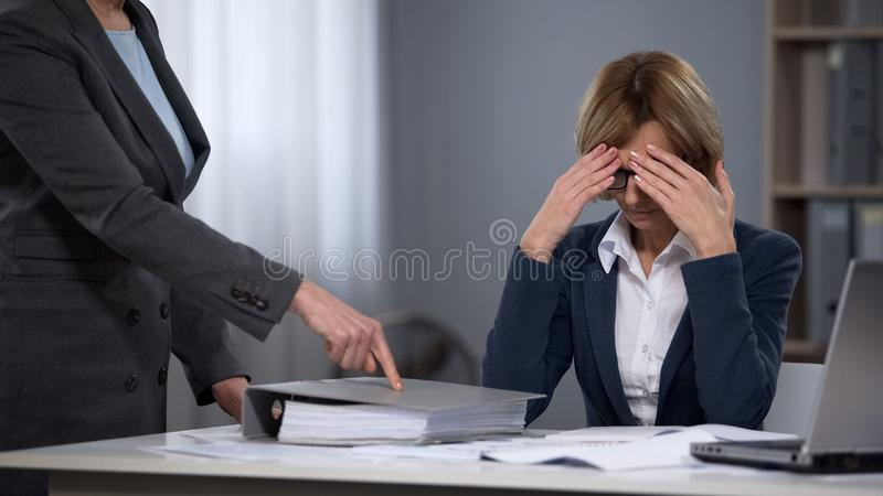 Tired stressed executive office worker feeling boss pressure, overtime work stock images