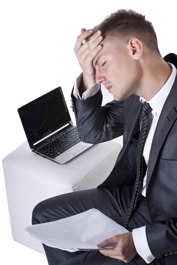 Tired And Stressed Young Businessman Royalty Free Stock Photos