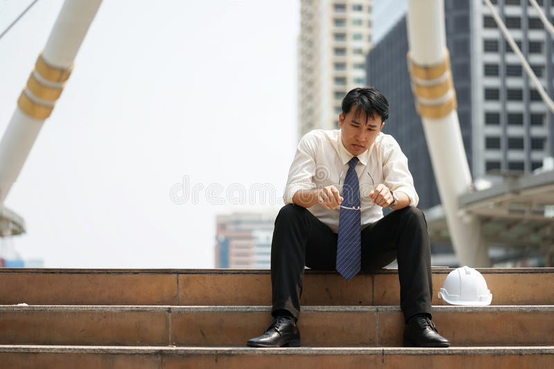 Tired or stressful businessman sit on the stairs after working royalty free stock photos