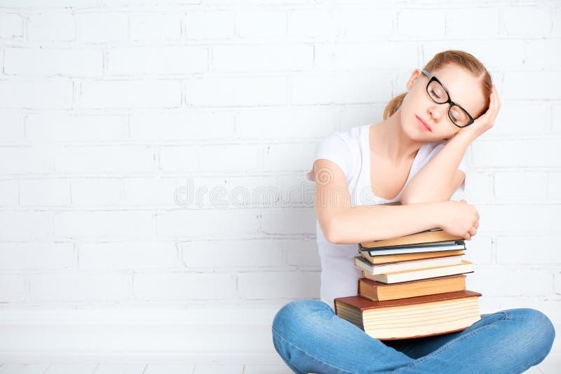 Tired student girl asleep hugging books royalty free stock photos
