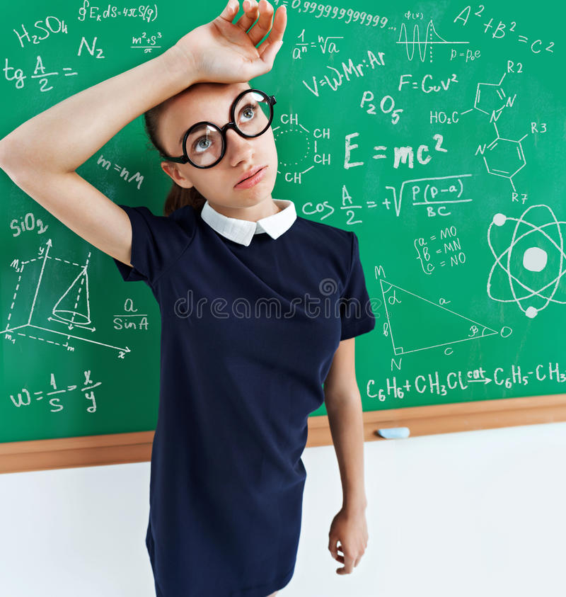 Tired student solved all the examples on the blackboard. royalty free stock images