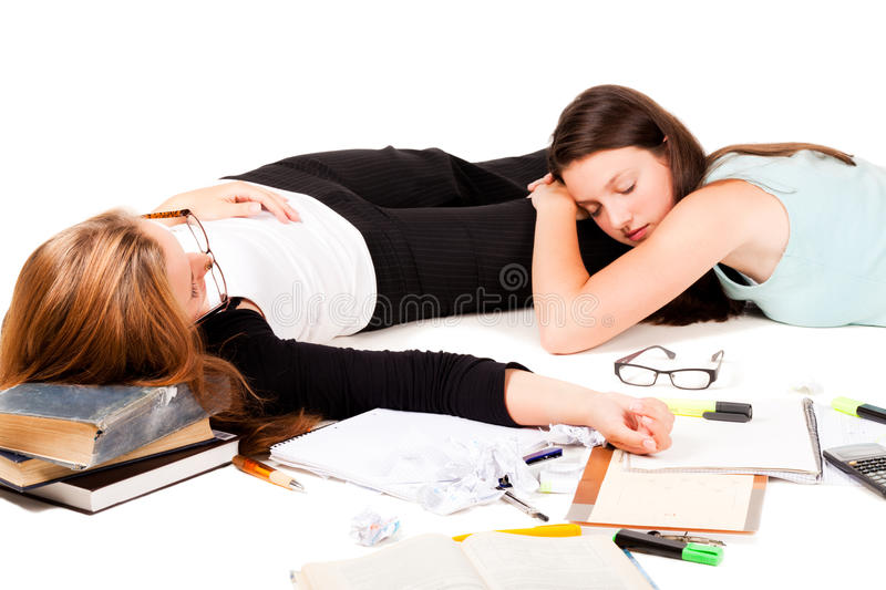 Tired of studing. Two students are sleeping after hard night of study. NOTE: Isolation has shadows royalty free stock photography