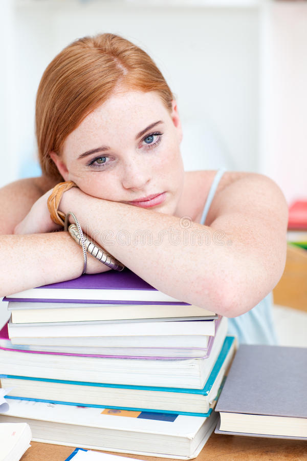 Download Tired Teeenager Sleeping In A Library Stock Photo - Image: 11932968