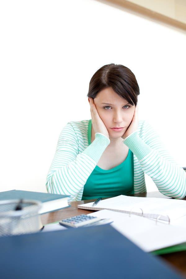 Tired teen girl studying stock photo