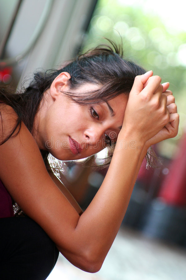 Tired Thinking Woman. Girl tired and thinking after hard exercises in the gym / Hands in the Head stock photography